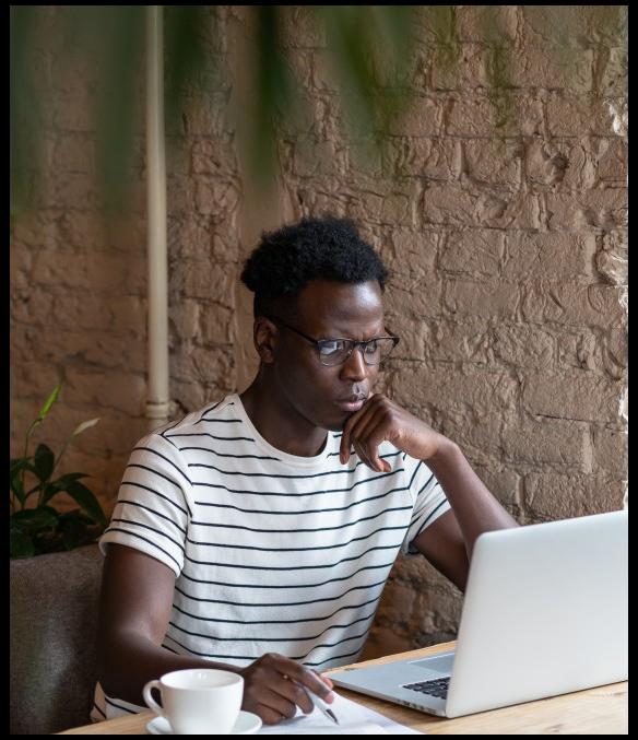 focused-millennial-black-man-student-in-stripped-t-shirt-wear-glasses-watching-educational-webinar-on_t20_9kKmgv-2